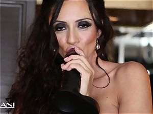 Ariella Ferrara wedges a yam-sized dark-hued fuck stick in her cunt