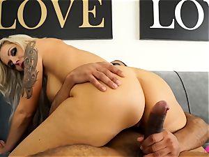huge-boobed towheaded Nina Elle taking a phat black man meat