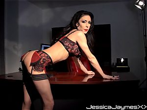 ultra-kinky dark haired Jessica Jaymes frigs her edible cooch pie in her office