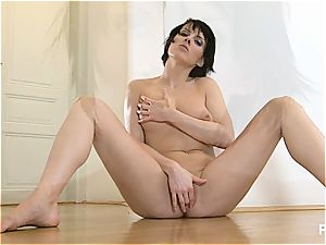 stretching her gams wide for you