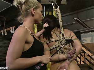 Kathia Nobili smacking the donk of steaming damsel with whip