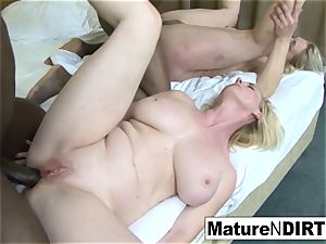 2 blond grandmothers have an multiracial fourway