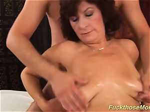 facial cumshot on big-titted fur covered mommy