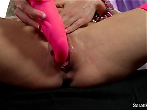 Sarah Jessie smashes herself with a pinkish toy
